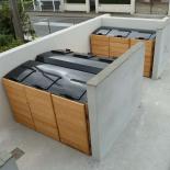 conception_fabrication_et_pose_de_conteneur_a_ordures_et_abris_pour_poubelles_bois
